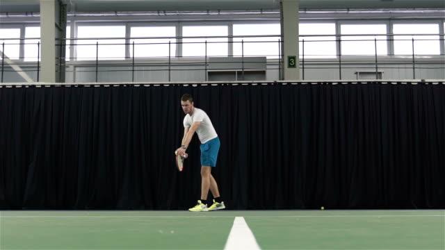 Man playing tennis. Slow motion video