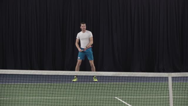 Man playing tennis video