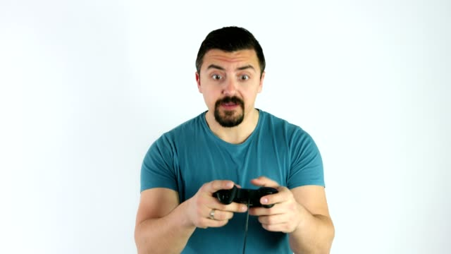 Man playing video games with a gamepad or joystick getting angry for losing the game video
