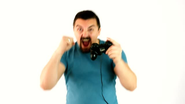 Man playing video games with a gamepad or joystick happy for winning the game video