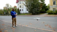man playing with a quadcopter drone video