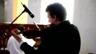 A man plays on a violin video
