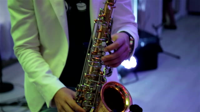 A man plays the saxophone video