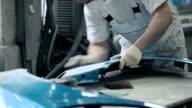 Man polishes detail of blue car. video