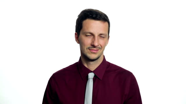 Man posing in business attire on white background video