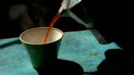 man pouring fresh hot coffee into the mug video