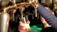 man pours a draft beer video