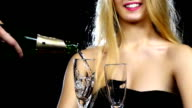 Man pours champagne into two glasses. Slow motion. Close up video