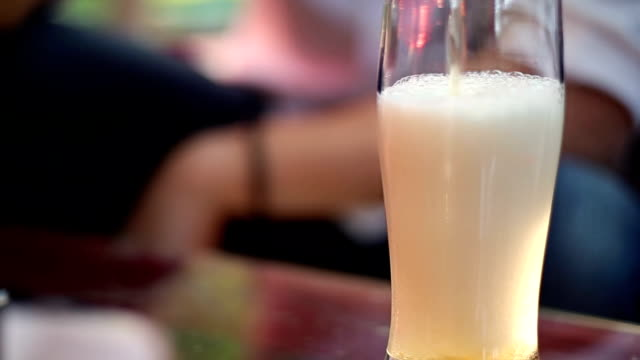 Man pours his beer Into the glass and drinks It video
