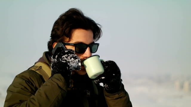 Man pours tea from a thermos winter video