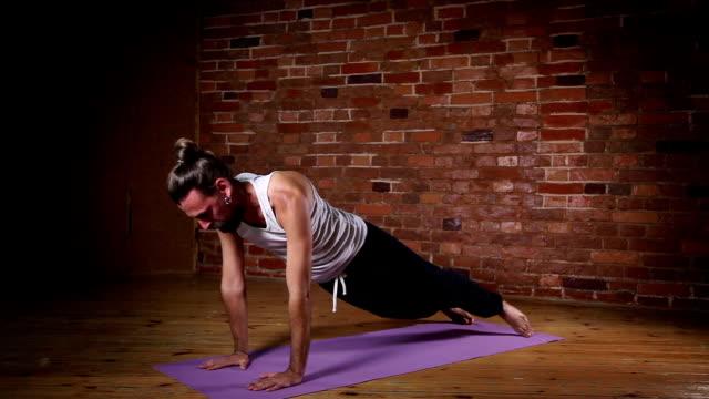 Man practicing advanced yoga video