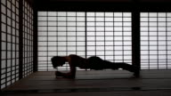 DS Man practicing yoga in tatami house video