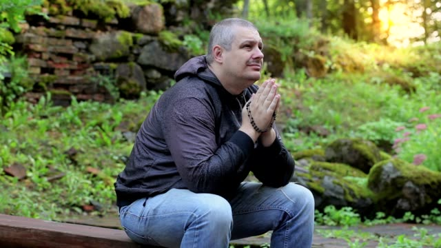 Man praying in outdoors video