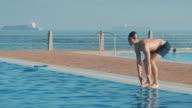Man preparing for swimming video