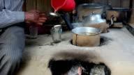 Man preparing Tea on a road side restaurant in India video