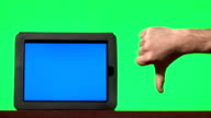 Man presenting digital tablet with a blue screen and gesturing video