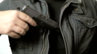 Man Pulls Handgun out of Coat in Slow Motion video