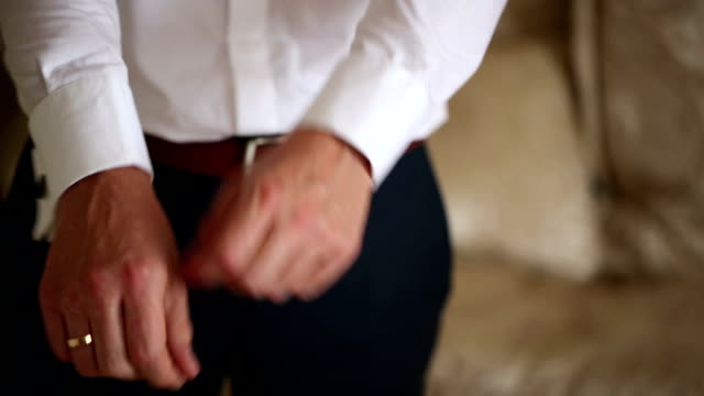 Man Puts on cufflinks, Bowtie, Jaket, Shoes video