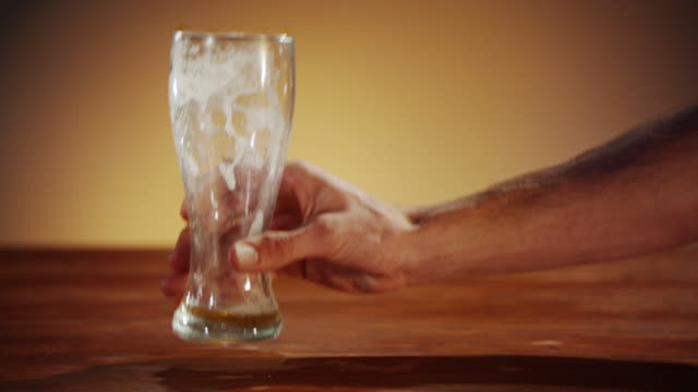 Man putting his empty beer onto the bar counter video
