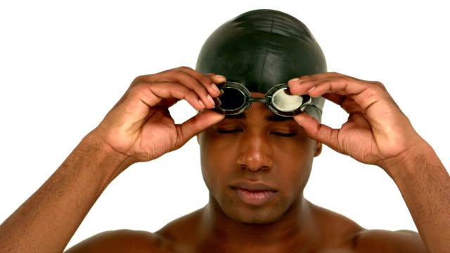 Man putting on swimming goggles video