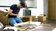 Man Putting Together Self Assembly Furniture In New Home video