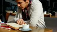 Man reading a book video