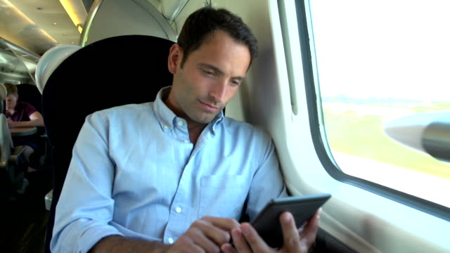 Man Reading E Book On Train Journey video