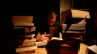Man Reading In The Library With Full Of Books video