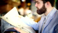 Man reading newspapers. video