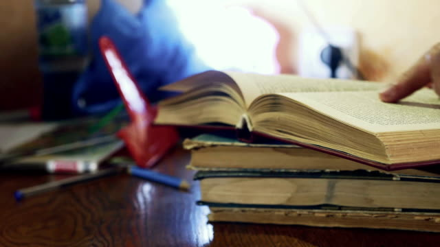 man reading old book close-up turns education the page video video