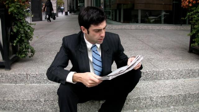 Man reads newspaper. video