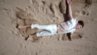 Man relax on beach. Man lying on sand. Beach relax. Man relaxing on sand video