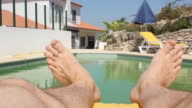 Man relaxes by pool video