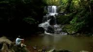 Man Relaxin By Waterfall video
