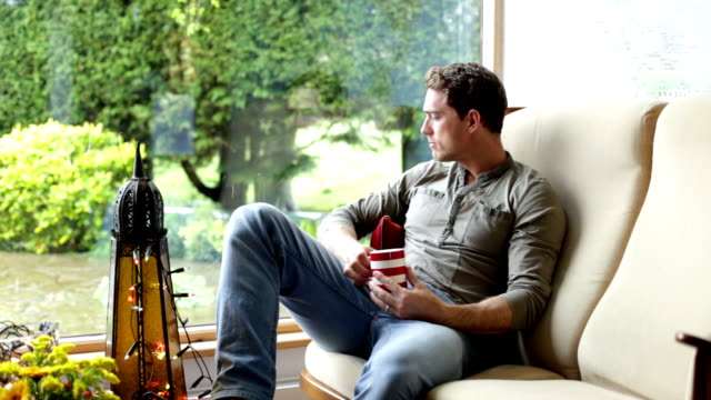 Man relaxing at home video