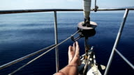 Man relaxing during cruise on a Sailing Boat video
