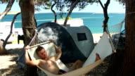 HD: Man Relaxing In A Hammock video