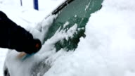 HD: Man removing snow from car window video
