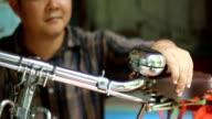 man repair bicycle bell video