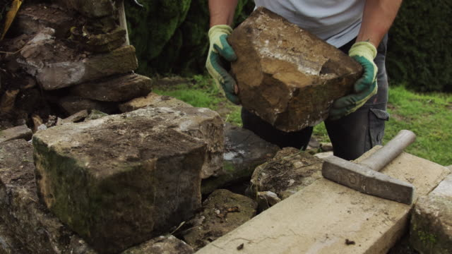 Man Repairing Dry Stone Wall video
