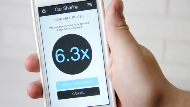 Man requests car and accepts high rates using car sharing application on smartphone video