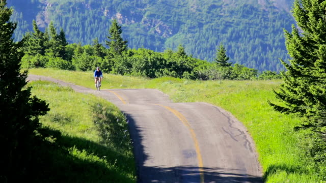 Man rides a bike in the mountains video
