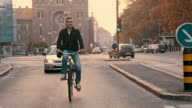 SLO MO Man riding a bicycle in the city video