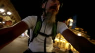 Man riding bicycle at night in city video