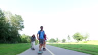 Man riding longboard with friends video