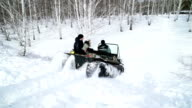 Man rolls the family for a snowmobile in the woods video