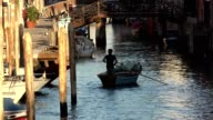 Man Rowing Boat In Venice Canal video