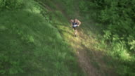 AERIAL Man running a marathon through forest video