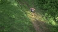 AERIAL Man running a marathon through the forest video