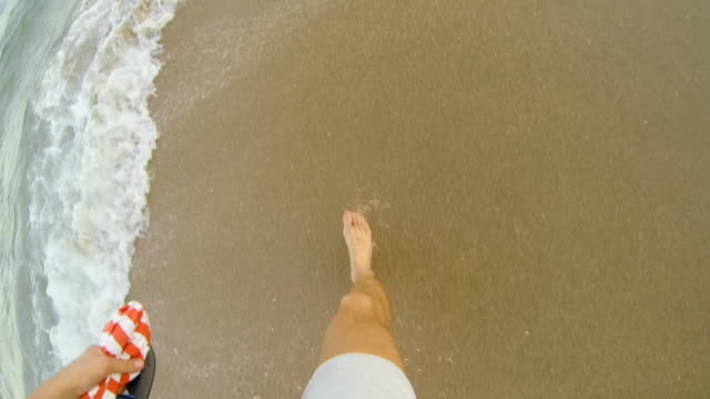 HD SLOW MOTION: Man Running Along The Beach video